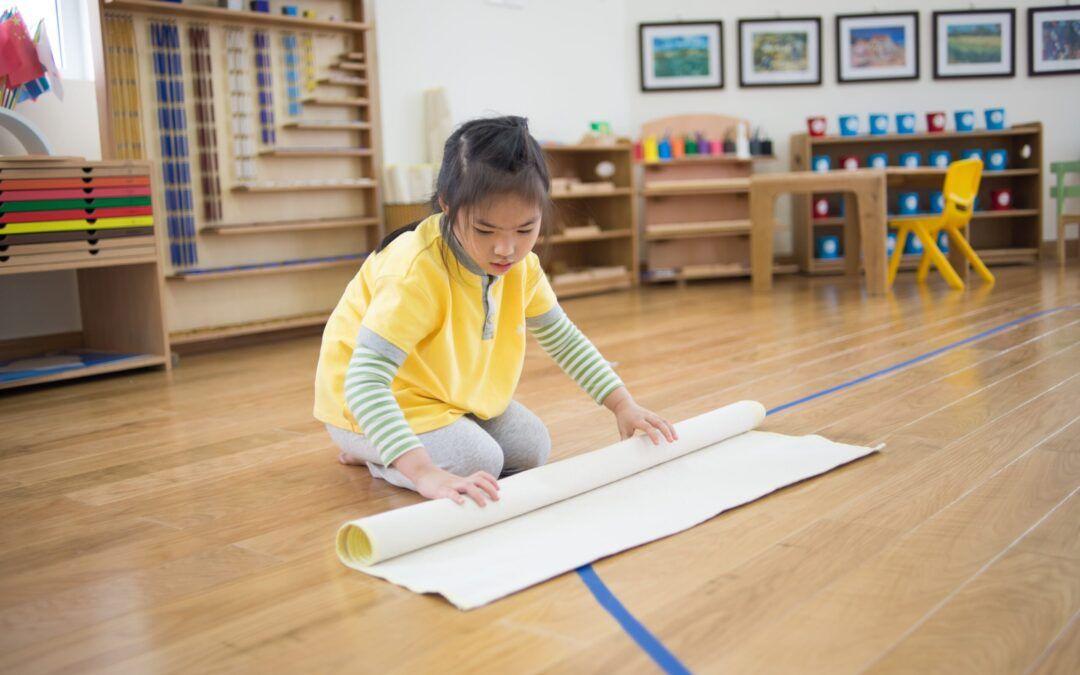 image of child in Montessori classroom to prepare for a Montessori work cycle.