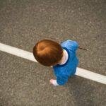image of child walking the line Montessori style.